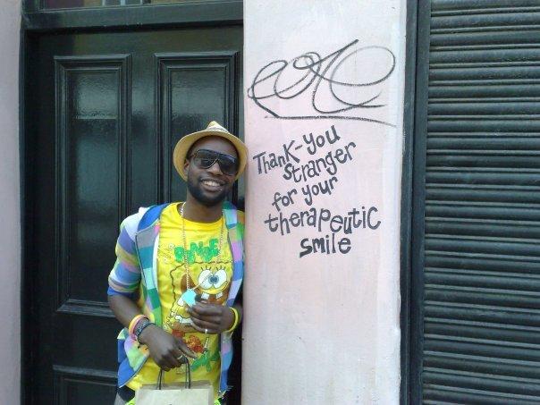 Ben Brown stood next to poetic graffiti type scrawl